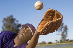 Man catching baseball